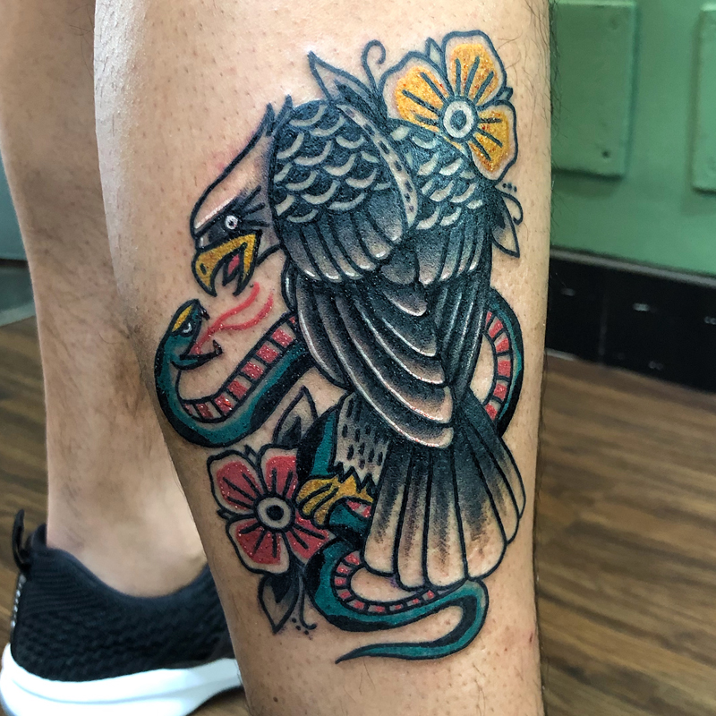Tatuaje tradicional águila y serpiente